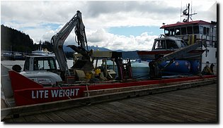 20150802_105441-Empty propane, 3000 gallons septic tank waste, 21' Alumaweld, excavator and forklift.jpg